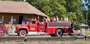 kids sitting on fire truck